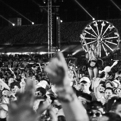 A girl is hoisted tall above a cheering crowd, as Pretty Lights performs on day 3 of EDC Vegas 2012