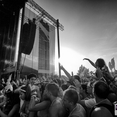 A crowd of tens of thousands cheer on the main stage performer at Electric Zoo 2012 as the sun sets.
